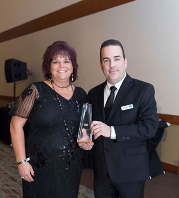 "Lynda Will and Nick Iannacone of UPS with their award for ""Community Champion of the Year"""