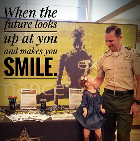 Riverside Sheriff Smiling Kid